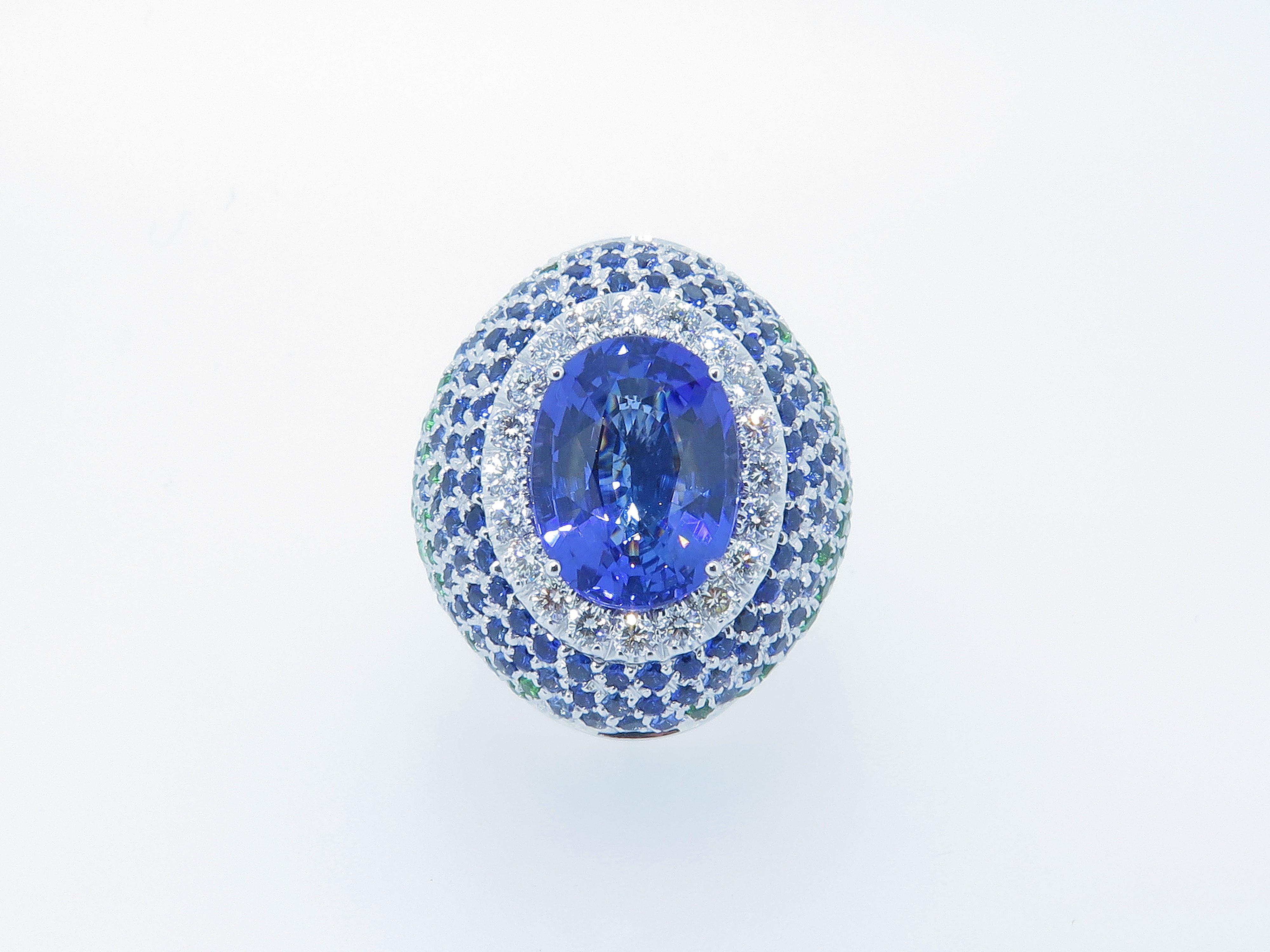 Anello con Tanzanite, Diamanti, Tsavorite e Topazio London blue